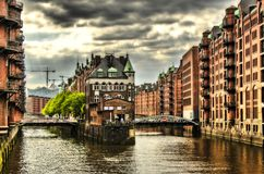 Historic buildings and steel bridge in the Speicherstadt in Hamburg, Germany Royalty Free Stock Images