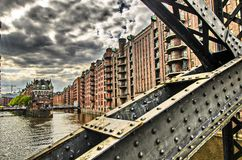 Historic buildings and steel bridge in the Speicherstadt in Hamburg, Germany Stock Images