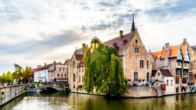 Historic buildings and a stone bridge over the Dijver Canal in the medieval city of Bruges, Belgium royalty free stock photos
