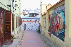 Historic buildings and street art in Literatu street, Vilnius, Lithuania Stock Photos