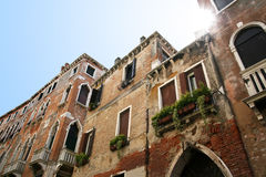 Historic Buildings and Sun. Block of historic buildings with impinging sun. Traditional venetian architecture Stock Images