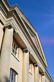 Historic buildng. Part of the exterior of a historic building in the UK with lens flare due to sunlight Stock Image