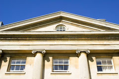 Historic buildng. Part of the exterior of a historic building in the UK with pillars Stock Images