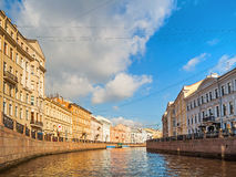 Historic buldings and embankment of Moika river in sunny day in St Petersburg, Russia Royalty Free Stock Images