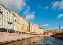 Historic buldings and embankment of Moika river in sunny day in St Petersburg, Russia Stock Photography
