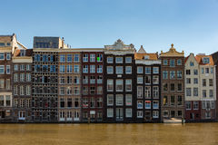 Historic canal houses on the Damrak. Royalty Free Stock Images