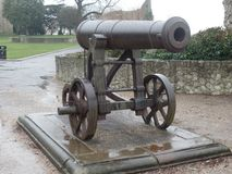 Historic cannon in Rochester, Kent. Historic cannon outside the castle in the city of Rochester, Kent Stock Photos