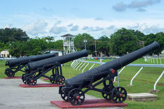 Historic Canon at the Garrison Savannah in Barbados. A Historic Canon in front of the Military Garrison of Barbados and pointed towards Barbadoss Horse Racing stock photo