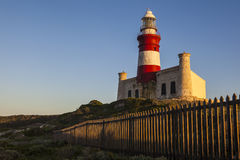 Historic Cape Agulhas lighthouse at sunrise Stock Photos