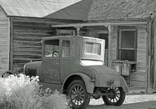 Historic Car & Home B/W. This photo was taken in a historic Ghost Town called Goldfield, NV Stock Images
