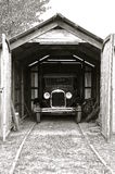 Historic car parked in an old wood garage Royalty Free Stock Image