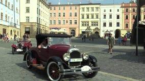Olomouc, Czech Republic, July 5, 2018: Historic cars veterans on a public car ride through city of Olomouc drive people stock video footage