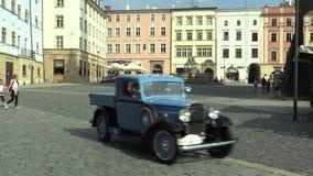 OLOMOUC, CZECH REPUBLIC, JULY 5, 2018: Historic car veteran on a public car ride through city of Olomouc drive people. Historic cars veterans on a public car stock footage