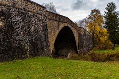 Historic Casselman Stone Arch Bridge - Appalachian Mountains - Garrett County, Maryland. A scenic, autumn view of the historic Casselman Stone Arch Bridge in the royalty free stock photos