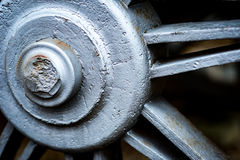 Historic cast iron train wheel detail. Detail of a wheel part of an historic train showing craftsmanship in construction and design royalty free stock images