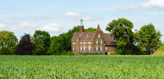 Historic castle in an agricultural environment in the Netherlands Stock Photography