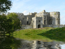 Historic castle by lake Royalty Free Stock Photography