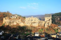 The historic Castle Larochette on the hilltop above the village in Luxembourg,. The historic Castle Larochette in Luxembourg, a fantastic medieval palace above Royalty Free Stock Photo