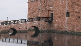 Historic castle of Paphos city. Side view of part of brick castle. Wooden castle bridge displayed in water. Beautiful view of entr. Ance to castle. Side view of stock video footage
