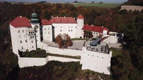 Aerial view to historic castle Pieskowa Skala near Krakow in Poland. Historic castle Pieskowa Skala near Krakow in Poland. Aerial spectacular view in beautiful stock video footage