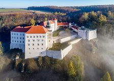 Castle Pieskowa Skala near Krakow, Poland. Historic castle Pieskowa Skala near Krakow in Poland. Aerial view in fall at sunrise in morning fog Royalty Free Stock Photo