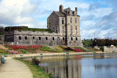Historic Castle of Quintin in Brittany France. Historic seventeen century castle and pond of old town Quintin in Brittany France Stock Photo