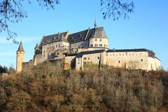 The historic Castle Vianden on the hilltop above the village in Luxembourg,. The historic Castle Vianden in Luxembourg, a fantastic medieval palace above the Stock Photography