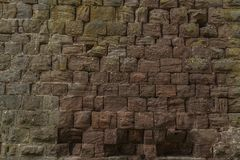 Historic castle wall from the middle ages. Old historic castle wall of hand-cut natural stone blocks royalty free stock image