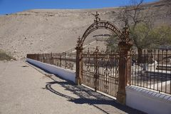 Historic Cemetery in the Atacama Desert. Historic British Cemetery from the era of nitrate mining in the Atacama Desert, in the grounds of Hacienda Tiliviche in Royalty Free Stock Photo