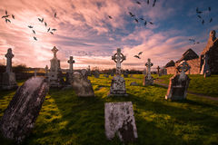 Historic cemetery in Clonmacnoise ,Ireland. Clonmacnoise is a monastic site overlooking the River Shannon in County Offaly. The extensive ruins include a Stock Photos