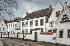 Historic Centre of Brugge, Belgium. Picturesque houses Beguinage in the Belgian city of Bruges Stock Images