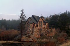 Historic Chapel. A beautiful stone chapel is built on rocks in the middle of a reflecting pond. This historic chapel, St. Malo Retreat Center, is used as a Royalty Free Stock Photos