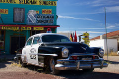 Historic Chrysler Police Car. Seligman, Arizona, USA – October 26, 2016: Chrysler Police Car in front of Historic Seligman Sundries Cafe along historic route Stock Photography