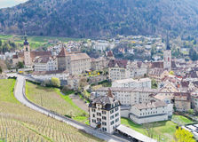 Historic Chur, Switzerland. Historic city center with church, castle  and old houses surrounded by vinyards and mountains in Chur, Switzerland Stock Images