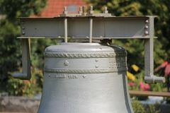 Historic church bell from 1924 on the cemetery of Kroeslin, Germany Royalty Free Stock Photos