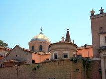 Historic church dome and spire, Tivoli, Italy. Side view of an historical church, with dome and spires, Tivoli, Lazio, Italy Stock Photos