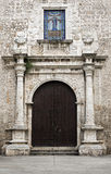 Historic church facade and entry door in Merida, Mexico Stock Photo