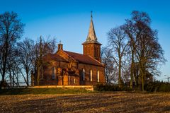 Historic church on the hill illuminated by the sun occurring in Pabianicka Hill, Poland. Parish of St. Marcin and Saint. Mary Magdalene in the Hill Pabianicka royalty free stock image
