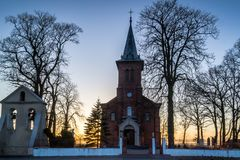 Historic church on the hill illuminated by the sun occurring in Pabianicka Hill, Poland. Parish of St. Marcin and Saint. Mary Magdalene in the Hill Pabianicka stock photography