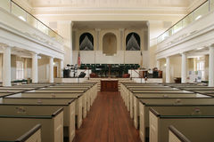 Historic church, interior. Interior of historic church with balconies and pews Stock Photos