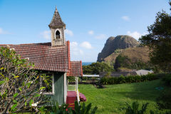 Historic Church in Kahakuloa Village. The sagging historic Church in Kahakuloa Village with Kahakuloa Head in the background Royalty Free Stock Images