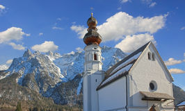 Historic church mittenwald and karwendel mountains Royalty Free Stock Images