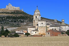 Historic church and ruin of a castle, Spain. Spain, provinie Burgos, autonomous region, community Castille and Leon; small city Castrojeriz: still life of church stock photography