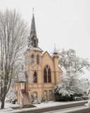 Historic church with snow. Historic Presbyterian church and surrounding trees covered with snow in Jacksonville, Oregon stock photography