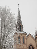 Historic church with snow. Historic Presbyterian church and surrounding trees covered with snow in Jacksonville, Oregon royalty free stock photography