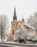 Historic church with snow. Historic Presbyterian church and surrounding trees covered with snow in Jacksonville, Oregon royalty free stock photo