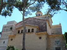 Rear of the Church of St. Jaume in Alcudia Majorca. The historic Church of St. Jaume with its high bell tower, home to the oldest bell in Majorca dating back to Royalty Free Stock Photography
