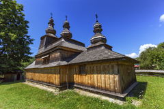 Historic Church of St. Nicholas in Bodruzal, Slovakia. Historic wooden church of St. Nicholas in Bodruzal by day, Slovakia royalty free stock photos