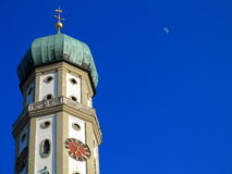 Church dome in rich blue sky. The onion dome of the minor basilica St Ulrich + St Afra in Augsburg, Germany. Baroque church architecture. Picture taken by a rich royalty free stock photo