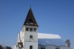 Historic Church. A historic church steeple is displayed against a blue winter sky Royalty Free Stock Image